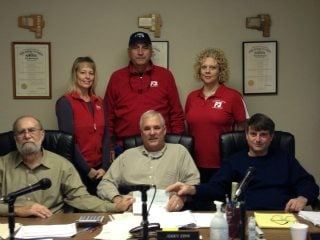 Pictured are OD Kim Harless, Board Members Brent Dixon and Jennefer Saxour, and the Vinton County Commissioners.