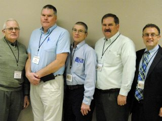 Newly elected officers Daryl Clark, Jim Percival, Shawn Ray, Mark McCabe and OSIA executive director Roger High.