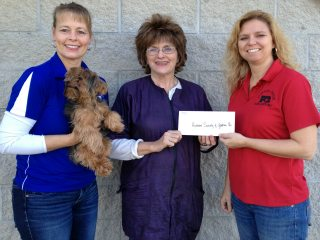 Pictured are Kim Harless,O.D., Bentley, Humane Society V.P. Diana Yates, and Communications Team Leader Melody Meldick