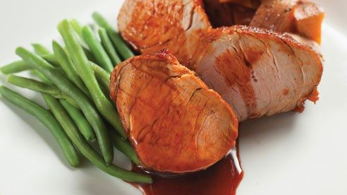 The sweetness of the maple syrup is complimented by smoky, warm and spicy seasonings to create a thick, fragrant and flavorful glaze for finely textured pork. Be sure to choose side dishes that offset the sweet nature of the recipe.