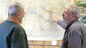 Rupp and Paul Avina look at a map of locations where the company has sold seeds.