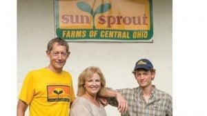 Steve and Pat Sauer along with their son Ed stand outside the family's Columbus business.
