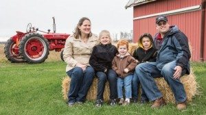 Greg McGlinch is joined by his wife Janet and children (from left) Maggie, Gabe and Patrick on their western Ohio farm.