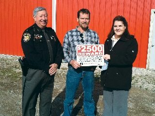 Sheriff Tim Bailey, reward recipient Steven Mattix and Ohio Farm Bureau Regional Supervisor Connie Ward.