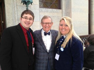 Jackson-Vinton Farm Bureau Member Brock Wolford,OSU President Gordon Gee, and Oak Hill FFA Student Mikka French