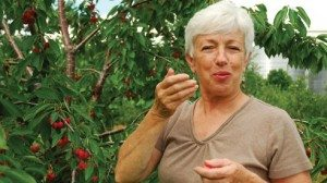 Betty Eshleman enjoying a fresh-picked snack
