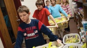 Volunteers in Athens County help distribute food on Friday in hopes that no children will have to start the school week hungry.