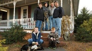 The Schlauch family. Back row, from left: Brandi, Sandy, David and Aaron. Sitting: Logan, 10, and Wyatt, 5, and farm dog, Nick.