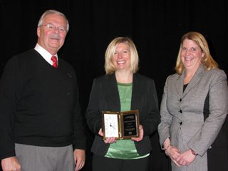 (Pictured l-r) Jack Fisher, OFBF executive vice president, Ms. Schlechter and Sandy Kuhn, AgriPOWER director.