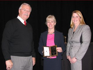 (Pictured l-r) Jack Fisher, OFBF executive vice president, Ms. Sutherly and Sandy Kuhn, AgriPOWER director.