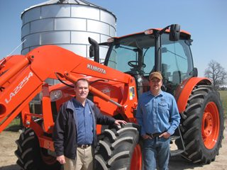 Tom Beam, Kubota and Erik Scott of Georgetown and the new M-series Kubota tractor.