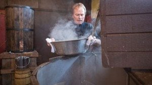 Joe adds hops to the mash tub during the process of making the whiskey.