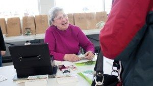 Charlene Stapleton collects money from the online customers, which will be passed along to local farmers.