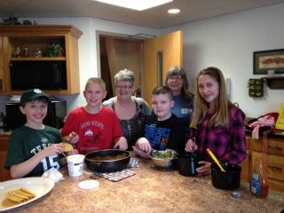 Homeschooled children learn to cook.