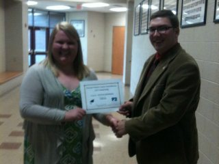 Board Trustee Jon Hensler awarding Hannah Thompson with the Jackson-Vinton Farm Bureau $500 Scholarship