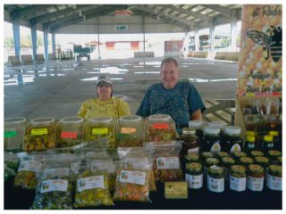 Bill and Board President Margaret Reid sell some of their delicious honey products!