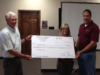 $2000 check awarded to OSU from Crawford County Farm Bureau.