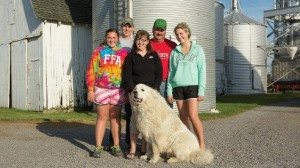 The Houts family, from left: Maggie, Seth, Michelle, Mark and Olivia along with their dog  Hercules.  Right This steer is one of two that Seth is currently raising as a  4-H project.