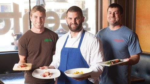 Matt (left) and Chris Vodraska (right) taste seasonal menu ideas with Chef Adam Lambert of Bar Cento.