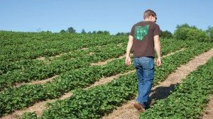 Matt conveys the farm's values on the back of his shirt.