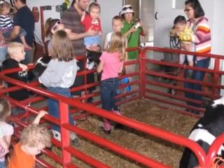 Families pet & learn about cows during Franklin & Madison county Farm Bureau's Breakfast on the Farm