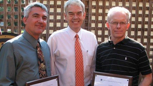 Food Product Development Contest winners Anthony Brubaker (left) and David LaRoe (far right) are congratulated by State Senator Randy Gardner (center).