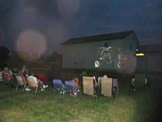"Movie Night on the Farm attendees watching ""Hoodwinked"" after an evening full of fun on the farm."