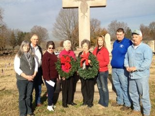Farm Bureau Board Trustees are pictured with the beautiful wreaths that will be placed on Veterans Graves