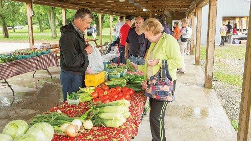 Elvin Burkholder sells produce at the Shelby Farmers' Market.