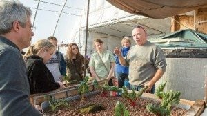 Doug discusses his unique growing system with a group of students visiting from Ohio State University.