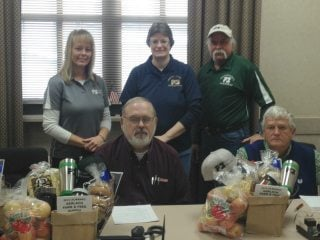 OD Kim Harless along with Scioto Board Trustees present baskets to commissioners for National Ag Week Recently