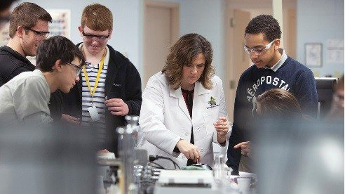 Teacher Rachel Sanders with students in the ag biotech class at the Global Impact STEM Academy.