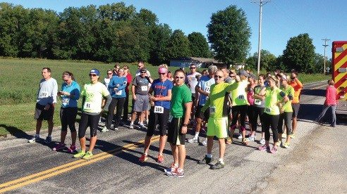 Harvest Hustle is a four-mile run walk that benefits the Farm to Family program.