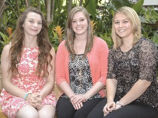 Leading the Ohio Farm Bureau State Fair exhibit, from left, are Kelsey Rumburg, Maggie Dean and Hayley Beck.
