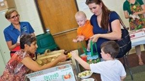 Families participating in Farm to Family make snacks with the produce available for them to pick up.