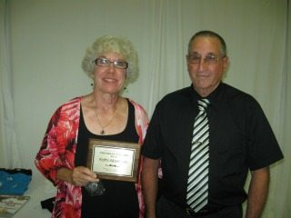 The President's Award was presented to Kathi Albertson by Milt Durben.
