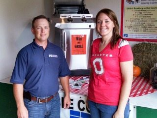 Pictured is Noble County Farm Bureau President, Jason Feldner with Kim Gibson winner of the grill.