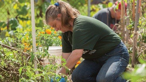 Green Machine member Janet Stem works in the garden that supports the program's farmers market.