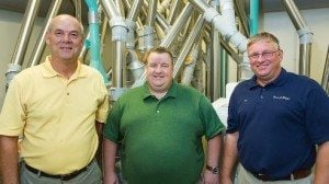 Ford Mennel (center) is the fifth generation to run Mennel Milling. With him is Flick, right, and Rick Longbrake, the company's vice president of grain.