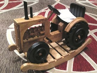 Items sold during the auction included cheese sculptures and a wooden tractor rocker.