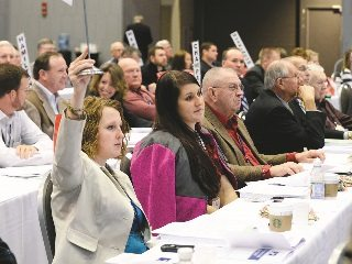 Medina County delegate Sarah Poling (left) participates in Ohio Farm Bureau's grassroots policy development process.