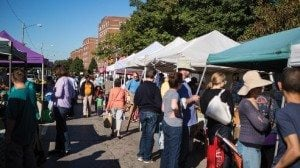 Crowds at the North Union Farmers Market at Shaker Square wait in lines for their purchases.