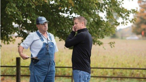 Before marrying into farming, Mike had no experience with agriculture. Now he works side-by-side everyday with his father-in-law Ray on the farm.