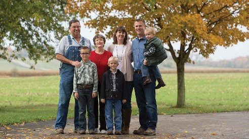 Working on the farm is a family affair. From left are his in-laws, Ray and Donna Noecker; sons Nathan, 9, Calvin, 6, and Blaine, 3, and his wife, Kim.