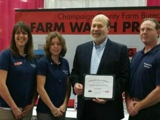 Dave& Mandy Crawford accept the County Activities of Excellence award from American Farm Bureau President Bob Stallman