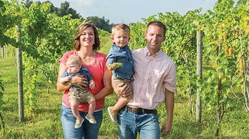 Aaron and Sarah Heilers and their sons William (2) and Elijah (1).