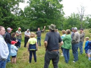 Cody Gilliam, Rice Energy, explaining details of well pad construction at Simpson Farm. Photo by Ron Simpson