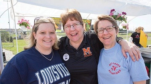 From left, Stacey Bettis of the Louisville Local School District, Rojean Cole of the Marlington Local School District and Betsy Cornell of the Alliance City School District are working to grow the Farm to School Program.