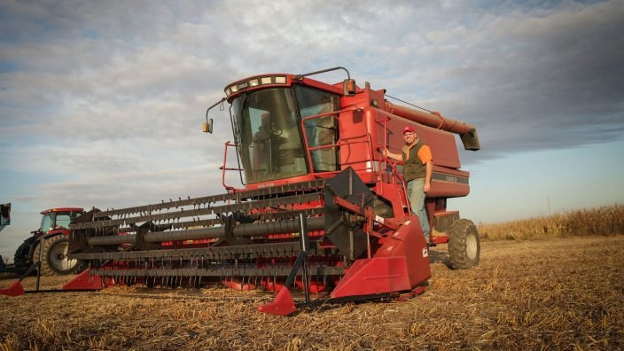 Man standing beside combine