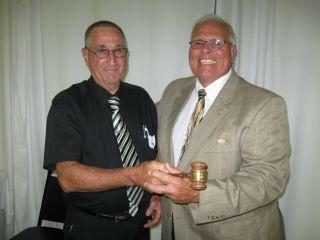 Milt Durben retiring president passed the gavel to Dr. Joseph